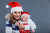 Portrait of happy family in Santa's hat — Stock Photo