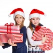 Two girl in Santa's hat with gift box — Foto de Stock