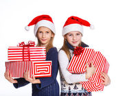 Two girl in Santa's hat with gift box — Stock Photo