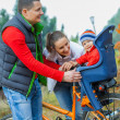Family with baby on bikes. — Stock Photo