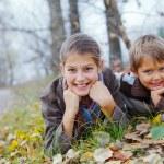 Kids in autumn park — Stock Photo #34567231