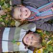 Kids in autumn park — Stock Photo #34567281