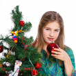 Girl decorating christmas tree. — Stock Photo