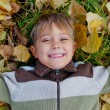 Boy in a autumn park — Stock Photo