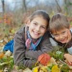 Kids in autumn park — Stock Photo #34606075