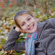 Girl in a autumn park — Stock Photo