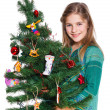 Girl decorating christmas tree. — ストック写真