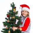 Girl decorating christmas tree. — Stock fotografie