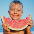 Boy eating watermelon — Stock Photo