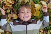 Boy in a autumn park — Stock Photo