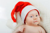 Baby in a santa suit. — Stock Photo