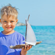 Boy with toy ship — Stock Photo #35163747