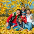 Family at autumn park — Stock Photo