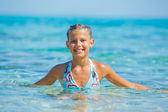 Swimming cute girl — Stock Photo
