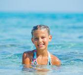 Swimming cute girl — Stock Photo