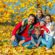 Family at autumn park — Stock Photo #36092781