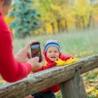 Baby boy in the autumn park — Stock fotografie