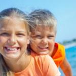 Happy kids on a beach. — Stock Photo