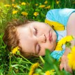 Sleeping boy on grass — Stock Photo #37311731