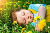 Sleeping boy on grass — Stock Photo