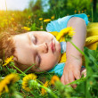 Sleeping boy on grass — Stock Photo #37375565