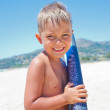 Boy has fun with the surfboard — Stock Photo #37466711