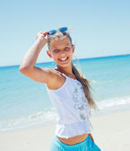 Cute girl on the beach — Stok fotoğraf