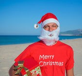 Men in santa hat — Stockfoto