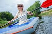 Woman kayaking — Foto Stock