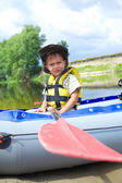 Boy kayaking — Stockfoto