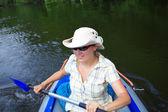 Woman kayaking — Stock Photo