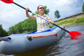 Woman kayaking — Stock fotografie