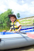 Boy kayaking — Stock fotografie