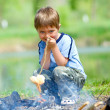 Boy grilling sausages — Stock Photo