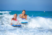 Summer vacation - surfer girls. — Stock Photo