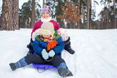Children on sleds in snow — Stock fotografie
