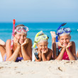Three happy children on beach... — Stock Photo #37773203