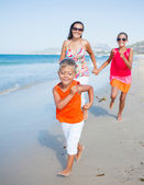 Cute boy with sister and mother on the beach — Foto de Stock