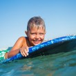Boy has fun with the surfboard — Stock Photo #37949851