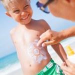 Applying sun cream — Stock Photo #37995175