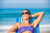 Girl relaxing on deck chair — Stock Photo