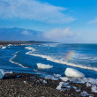 Stock Photo: Ice blocks on sand beach.