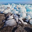 Ice blocks on a sand beach. — Stock Photo