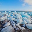 Ice blocks on a sand beach. — Stock Photo #38295325
