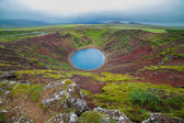 Lake in round volcano crater — Stock Photo