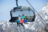 Skiers on a ski lift. — Stock Photo
