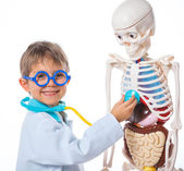 Little doctor with skeleton — Stock Photo