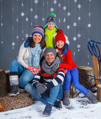 Funny family in winter clothes — Stock Photo