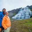 Couple of tourists and Dynjandi. Iceland — Stock Photo