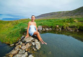 Woman in geothermal spring — Stock Photo